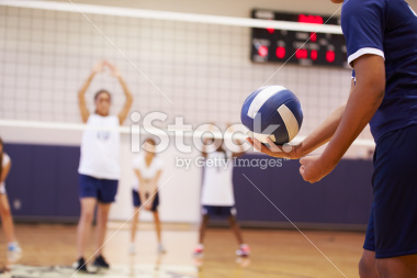 stock-photo-42229650-high-school-volleyball-match-in-gymnasium